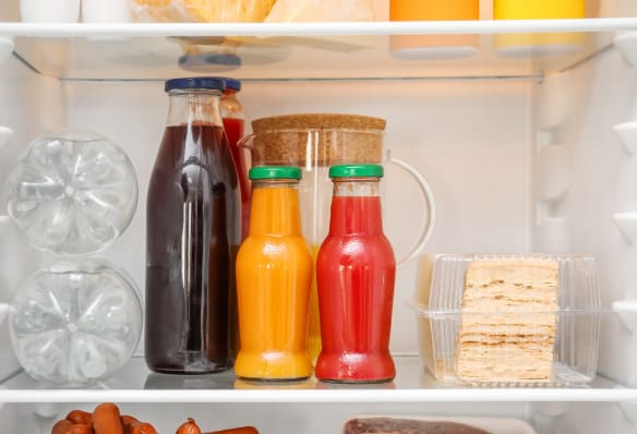 juice in glass bottles in fridge